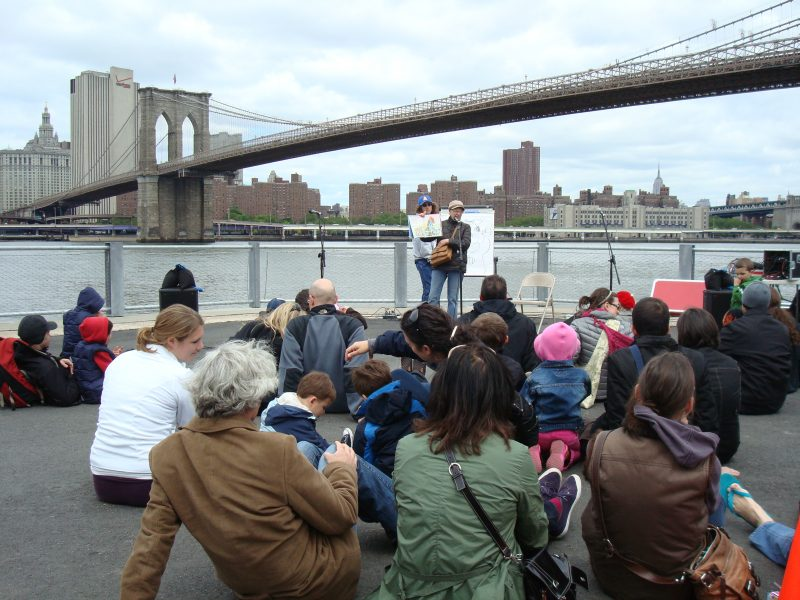 Betsy reading at the opening of the Brooklyn Bridge Park
